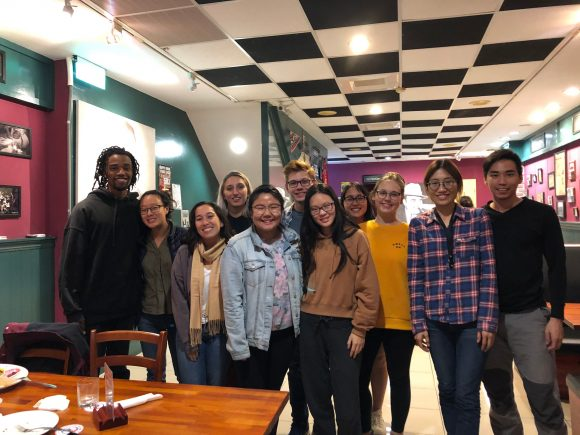 Sun and ten others pose for photo inside restaurant on Thanksgiving
