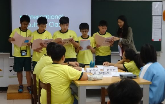 Wong guides five Taiwanese students reading in front of the class