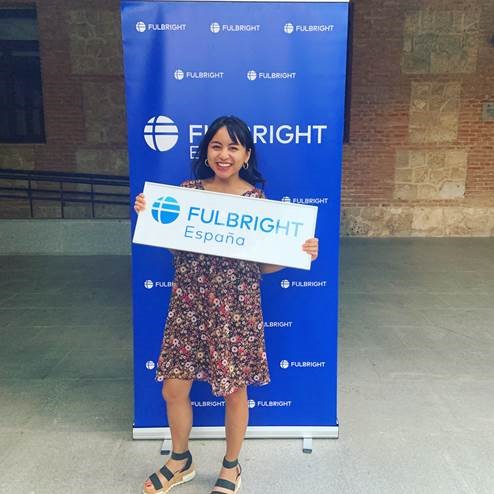 Carmina holding Fulbright sign