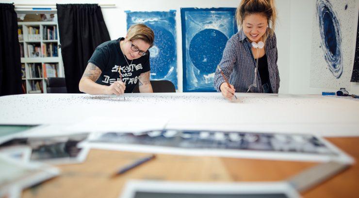 Student working with Professor Halloran in Art Studio