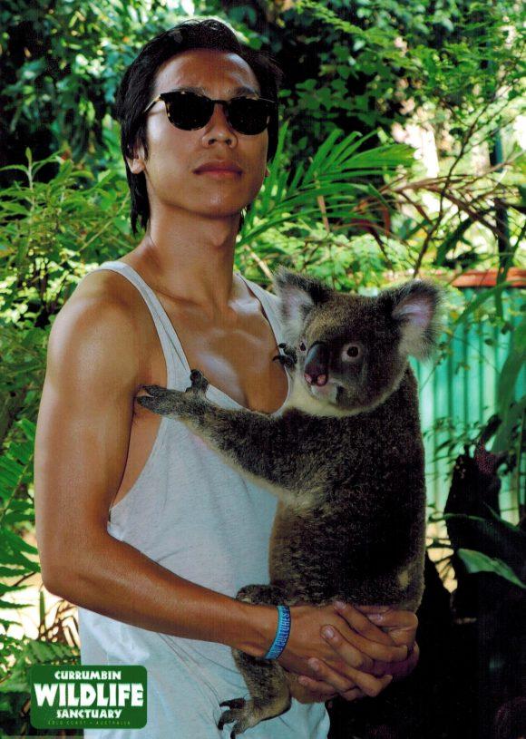 Student with koala in Australia