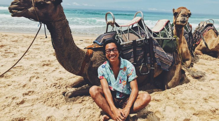 Student with camel in Australia