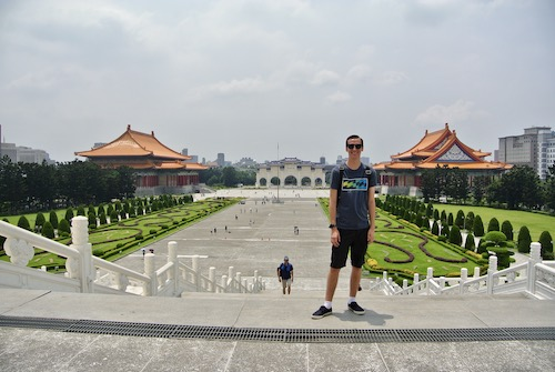 Ryan standing in front of open area outside of a Temple in Taiwan during his travel course.