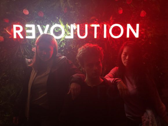 Students in front of Revolution sign