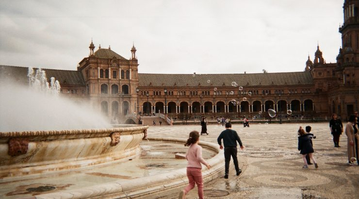 Kids run around at Plaza de Espana