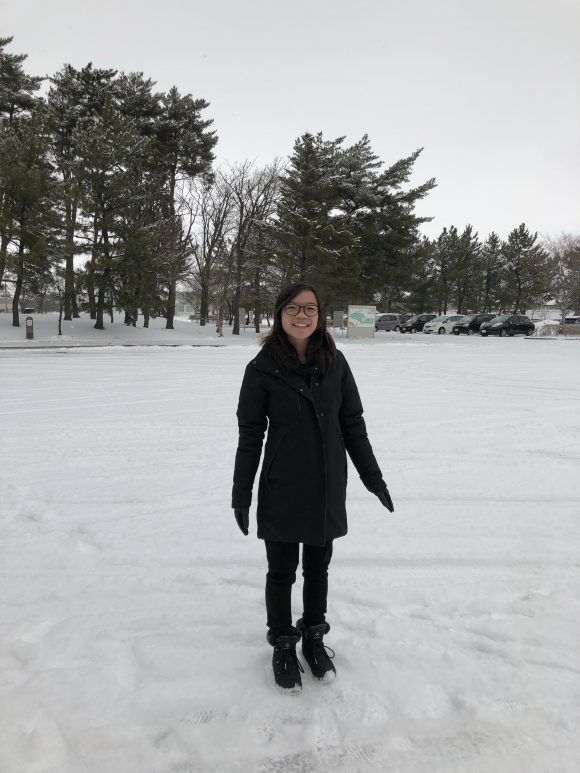Student standing in the snow in Japan