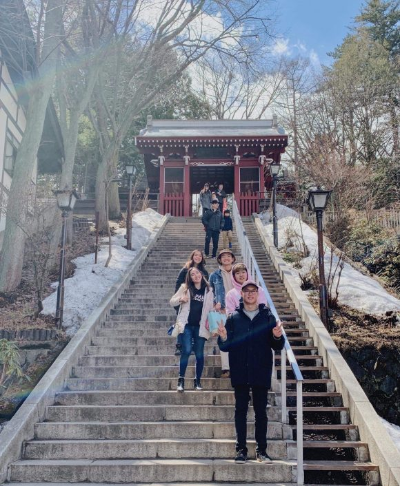 Students on steps in front of Japan temple