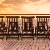 Chairs on a ship deck during sunset