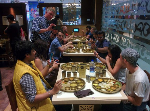 Students eating traditional Indian food